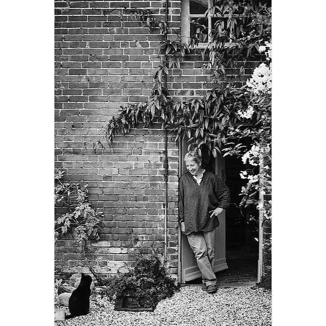 Sophie Norton with her cat Poppy in the doorway of Waterlock house @branchingoutantiques featured in Issue #01 Country Living ~Vintage Home #garden #kentgarden #frenchantiques .